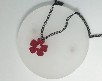 Small Flower red Necklace. Laser cut from acrylic. by Emily M A Parkin