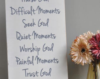 Happy moments Praise God, Difficult moments Seek God, painted wood sign.