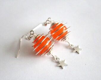 SATELLITE earrings and orange beads
