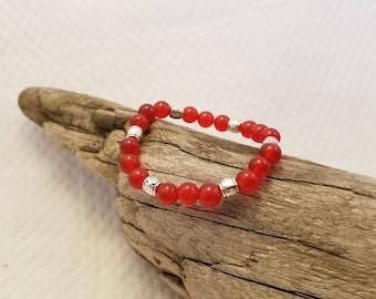 Red Jade stretch cord bracelet.