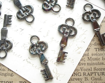 Skeleton Key Charms. 12 Antiqued Gunmetal Vintage Style Small Key Stampings. Steampunk, Jewelry, Scrapbooking, Crafts, Destash Supplies Sale