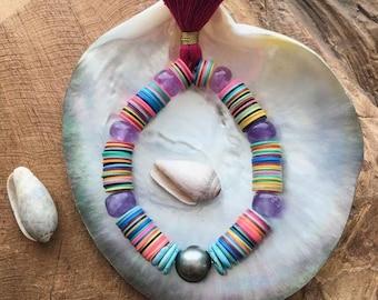 Bracelet perle Tahiti   Sleeping Beauty Turquoise   Disque vinyle africain   Cap améthyste   Gland   Bohème