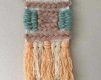 textured weave: orange, brown, and teal.