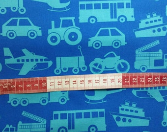 Blue transport design with cars, trucks and planes. 1/2 meter Clothing and craft 100% Cotton Fabric