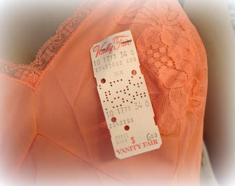 vintage 1960s Vanity Fair lingerie full slip yummy coral nylon and lace slip nightie new old stock with original price tags still attached