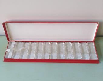 12 vintage Val St. Lambert Crystal knife rests