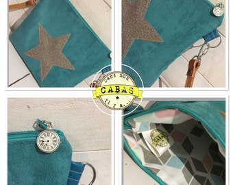 Suedine turquoise shoulder bag and leather strap