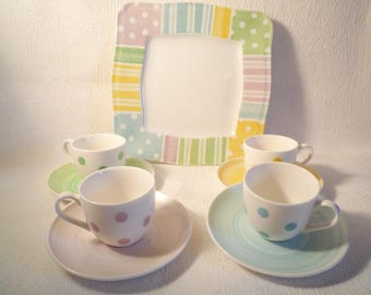 Coffee cups and multicolored polka dot cake plate