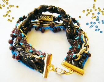 Multi strand bracelet, blue and chocolate