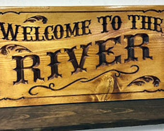 Welcome To The River Carved Sign