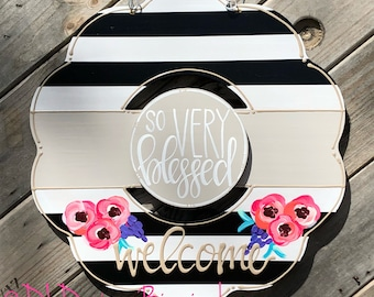 Floral wreath door hanger with stripes and hand lettering