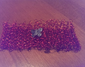 red, thin, crocheted wire bracelet