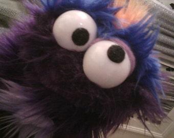 Funky little fuzzy purple monster puppet