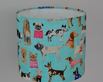 "Gorgeous hand rolled drum lampshade in pale blue cotton ""dogs"" fabric by Carolyn Gavin for Wyndham Fabrics."