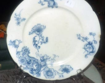 Antique (1891-1914) Grindley Marseilles hand-decorated flow blue dinner plate. Blue florals on white, scalloped edge. Flawed (see below).