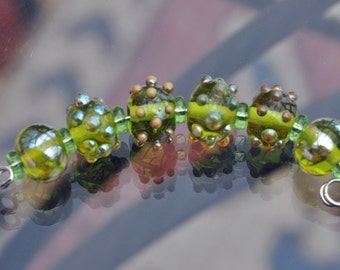 Lampwork lime green beads with raised dots for jewellery making.