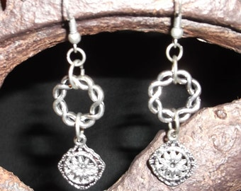 Silver tone ornate dangle earrings