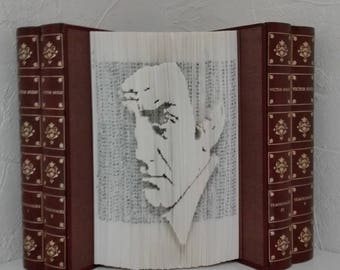 Folded book-cut Lino Ventura