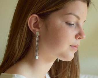 Long chain and ring on chip earrings