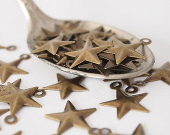 30 Metal Star Stampings Charms  Embossed Antique Brass Size 16 x 13mm Hole 1mm