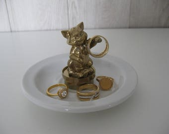 with its golden figurine jewelry dish