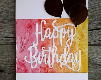 Birthday card - die cut and watercoloured in red, yellow and orange with three gold balloons