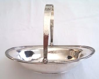 1874 Gorham sterling silver swing handled oval basket, Greek Key border design, hand hammered