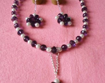 Earrings and necklace in white and purple pearls
