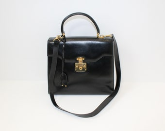 Vintage 1980s Gucci black leather kelly bag designer handbag satchel with detachable shoulder strap keys and dust cover
