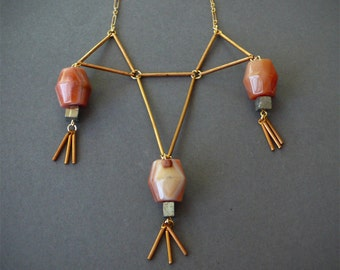 Triangle bib necklace with Botswana orange agate and pyrite cubes