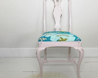 Beachy palest peach and vibrant turquoise floral accent chair