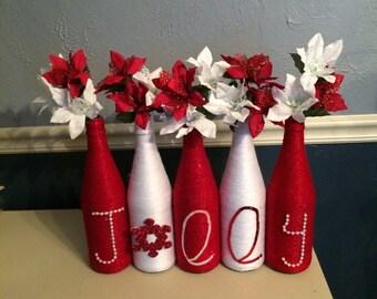 Shimmery Red & White Christmas Wine Bottle Set that spells Jolly