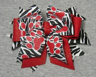 Cheer Bow - Black & White Zebra Spikes topped with a Red Glitter Bow and Black and White Zebra with Red Glitzy Glitter Paw Prints