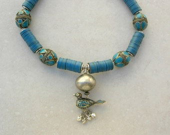 Teal Blue Bird, Afghan Enameled Bird & 4 Large Afghan Beads, 1 Large Etched African Bead, Vinyl African Disks, Necklace by SandraDesigns