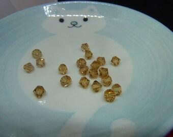 Set of 20 beads - LIGHT COLORADO Topaz - SWAROVSKI 6 mm