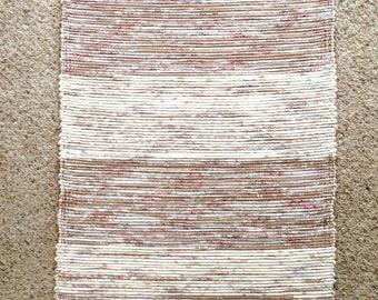 beige, white and rose rag rug