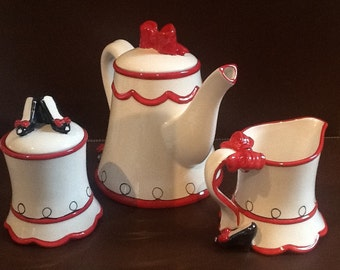 Whimsical Tea Set with Red Bows and High Heels