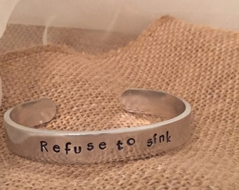 "Inspirational cuff bracelet Refuse to Sink with ship design 6"" x 3/8"" silver toned aluminum hypoallergenic"