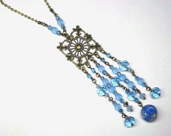 Necklace necklace Crystal beads and blue glass, string and print bronze - coloured Collection
