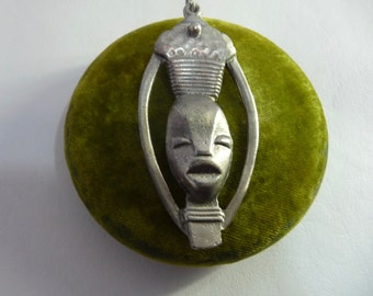 Tribal pendant. African mask. hammered Tin. Hand made. African crafts.