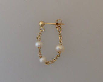 Single 18k gold & pearl/ruby chain earring