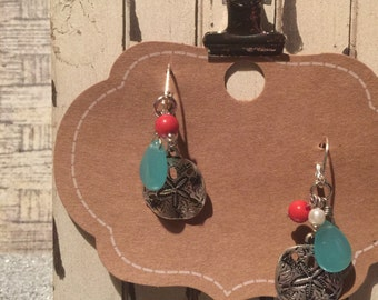 Danity turquoise  & coral bead accented with a silver dollar on lever back wires.  Overall length just a little over 1""