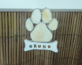Stained glass dogs paw print with bone