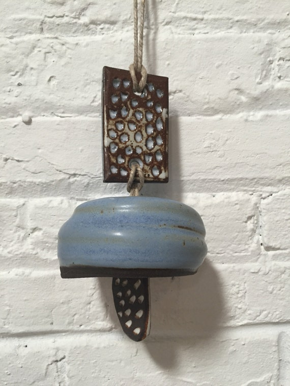 ceramic bell // matte blue glaze // speckled black stoneware // wheelthrown // carved