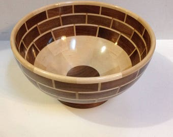 Segmented wood bowl made from walnut and maple.