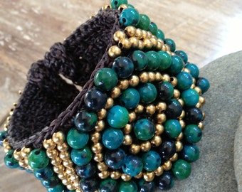 beaded bracelet with gold and green beads