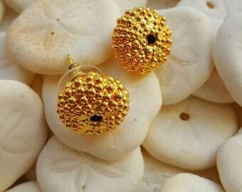 A pair of metal sea urchin earrings