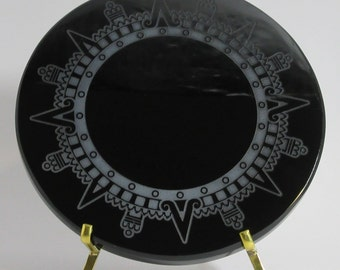 Engraved black obsidian mirror - Sun crown of the Aztec calendar