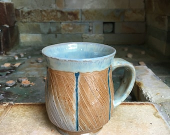 Hand thrown and altered ceramic soda fired cup.  Similar available.