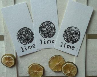 Three LIME linocut bookmarks